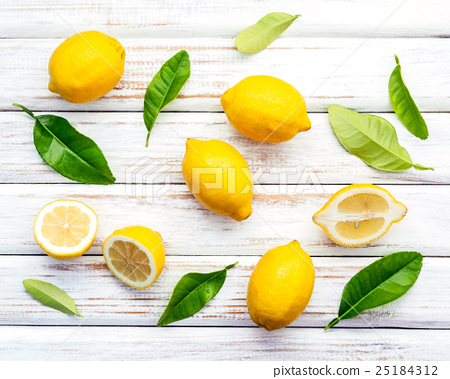Fresh lemons and  lemons leaves  25184312