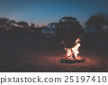 Burning camp fire at dusk in camping site 25197410