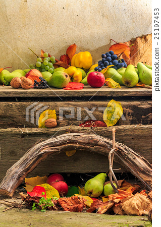 autumn still life with fruit in leaves on board 25197453