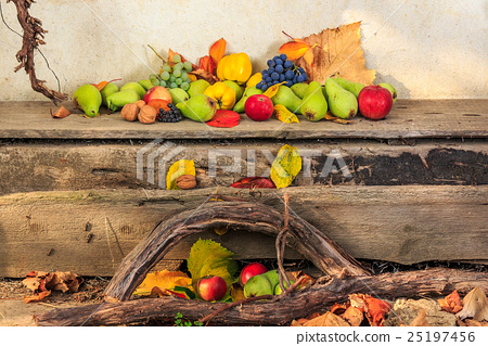 autumn still life with fruit in leaves on board 25197456