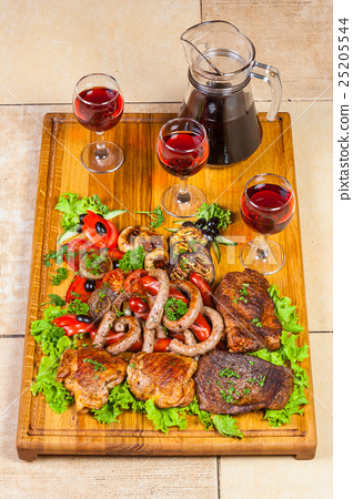 grilled meat, sausages  and  herbs with wine 25205544