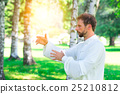 An instructor practice of Tai Chi Chuan in the park. 25210812