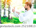 An instructor practice of Tai Chi Chuan in the park. 25210813