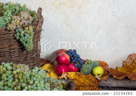autumnal still life with fruit and leaves 25234265