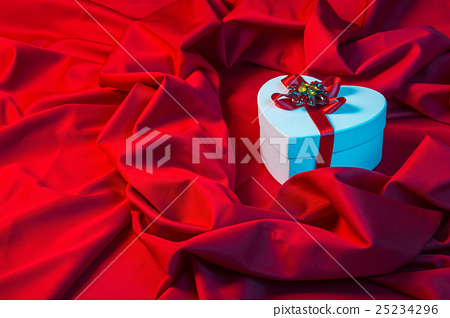 love card with heart on a red fabric in blue 25234296