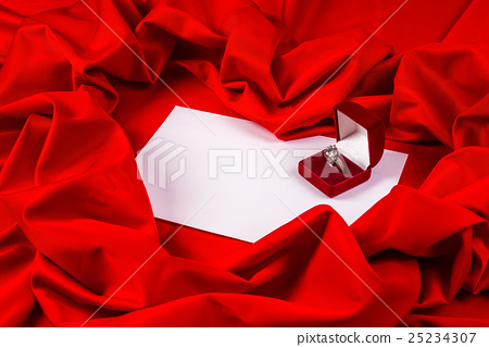 love card with diamond ring on a red fabric 25234307