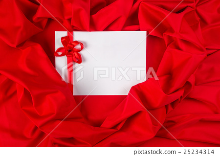 love card with ribbon on a red fabric 25234314