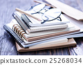 Stack of spiral notebooks 25268034