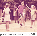 Kids in school age playing together with jumping rope 25276580