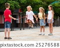 children with jumping rope at playground. 25276588