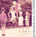 children with chinese jumping rope . 25276600