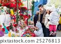 Happy family in Christmas fair 25276813