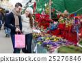 Couple buying Christmas flower at market 25276846