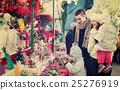 Happy family in Christmas fair 25276919