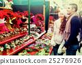 Couple buying Christmas flower at market 25276926