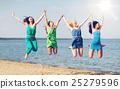 girls jumping on the beach 25279596