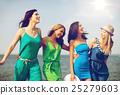 girls walking on the beach 25279603