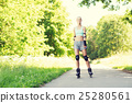 happy young woman in rollerblades riding outdoors 25280561