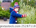 beautiful smiling little boy holding christmas 25287118