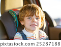 Portrait of little kid boy sitting in safety car 25287188