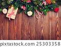 Fir tree branch with christmas lights, gift box  25303358