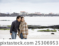 Middleaged Asian Couple Taking a Walk on Beach 25306953