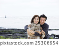 Middleaged Asian Couple Taking a Walk on Beach 25306954