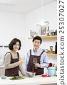 Middleaged Asian Couple Having White Wine in Kitchen 25307027