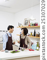 Middleaged Asian Couple Having White Wine in Kitchen 25307029