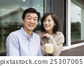 Middleaged Asian Couple Sitting, Having coffee at Porch 25307065