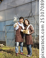 Middleaged Asian Couple Working on Field 25307089