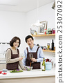 Middleaged Asian Couple Having White Wine in Kitchen 25307092