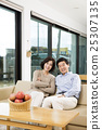 Middleaged Asian Couple Smiling in the Living room 25307135
