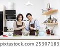 Middleaged Asian Couple Having White Wine in Kitchen 25307183
