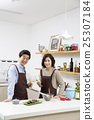 Middleaged Asian Couple Having White Wine in Kitchen 25307184