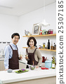 Middleaged Asian Couple Having White Wine in Kitchen 25307185
