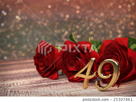 birthday concept with red roses on wooden desk 25307861