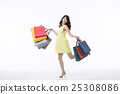 A young woman carrying a bunch of shopping bags 25308086