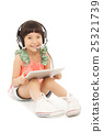 little student girl sitting and holding  tablet 25321739