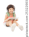 little student girl sitting and holding a tablet  25322003