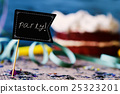 confetti, cake and signboard with word party 25323201