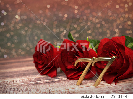 birthday concept with red roses on wooden desk 25331445