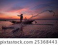 Silhouette of Asian fisherman on wooden boat 25368443