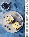 Blueberry bars, cake, cheesecake on a grey plate 25371073