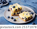 Blueberry bars, cake, cheesecake on a grey plate 25371078