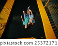Couple lie on trampoline in the park 25372171