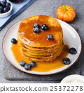 Pumpkin pancakes with maple syrup and blueberries 25372278