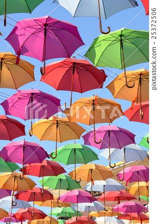 colorful umbrellas with blue sky in the background 25372506