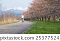 Old man riding a bike at The Kaji Riverbank  25377524