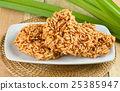 Rice cracker on wooden background 25385947
